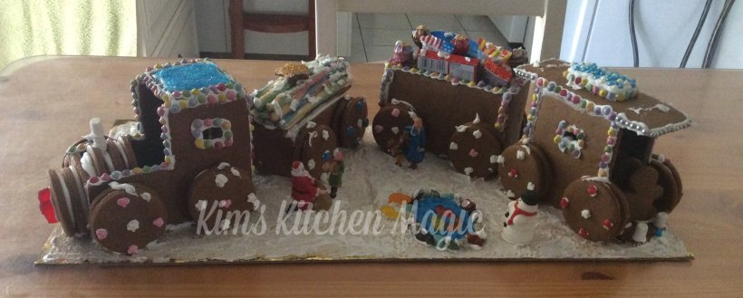 Gingerbread train with snow and laeke